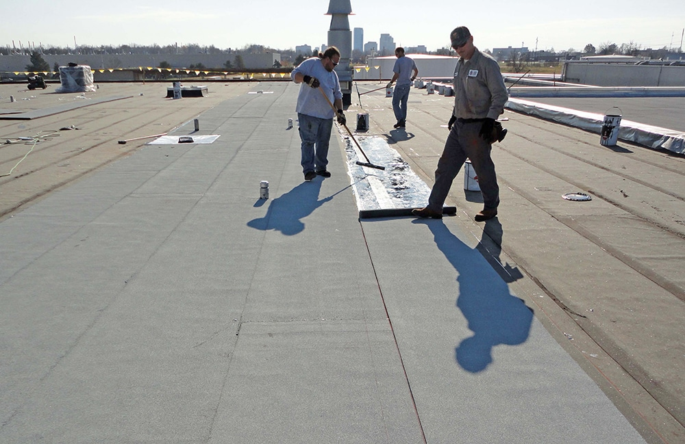 Roofers working on a commercial roof